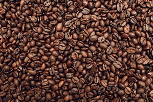 Fond d'écran de texture de grains de café torréfiés brun.