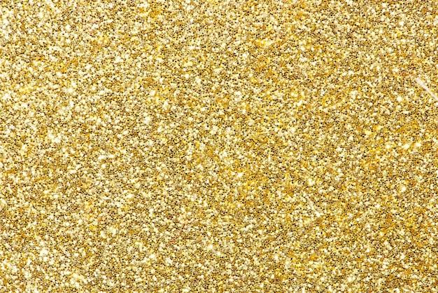 Fond festif de paillettes dorées brillantes