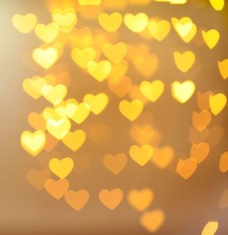 Fond de fête des lumières en forme de coeurs