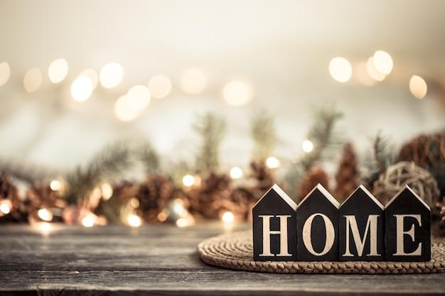 Fond de fête avec des lumières avec l'inscription à la maison