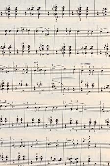 Fond de feuille de notes de musique. bouchent la feuille de notes de musique.