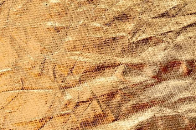 Fond de feuille d'or froissé