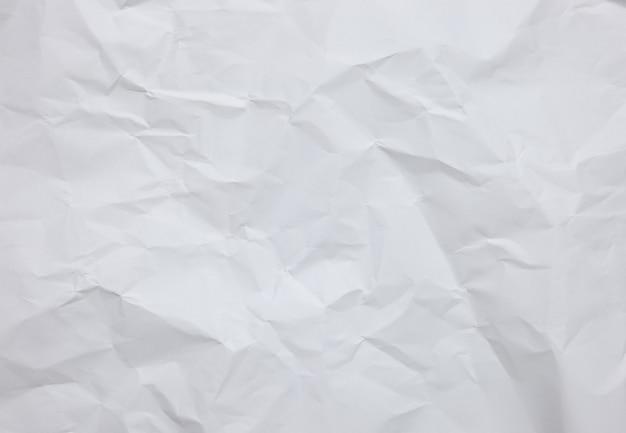 Fond de feuille de papier froissé blanc avec textures