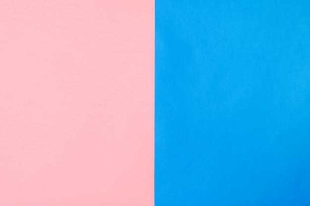 Fond de feuilles de papier rose et bleu disposées verticalement. style plat.
