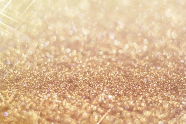 Fond flou de paillettes d'or