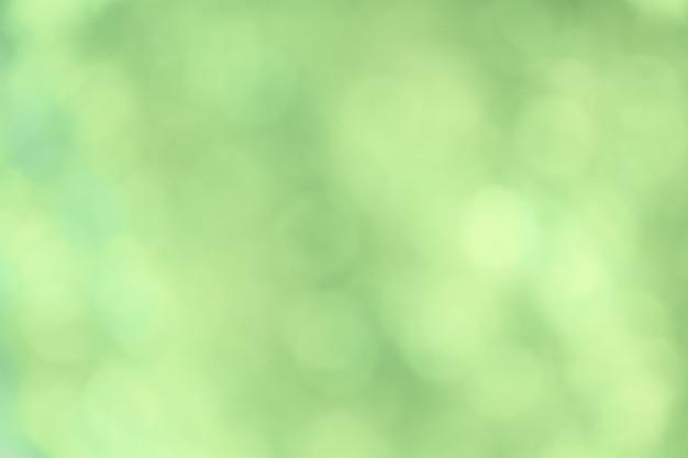 Fond flou vert naturel, lumières de bokeh.