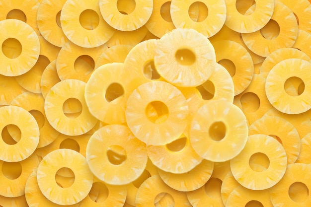 Fond fruité jaune d'anneaux d'ananas