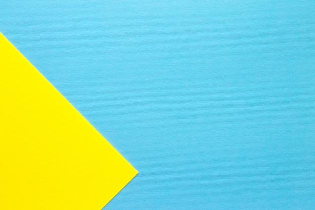 Fond géométrique en papier pastel bleu et jaune