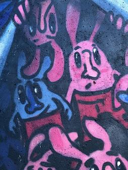 Fond graffiti abstrait art de la rue des lignes de dessin colorées et lumineuses sur le mur