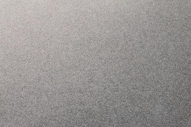 Un fond grainé de texture en métal. matériau en acier inoxydable.