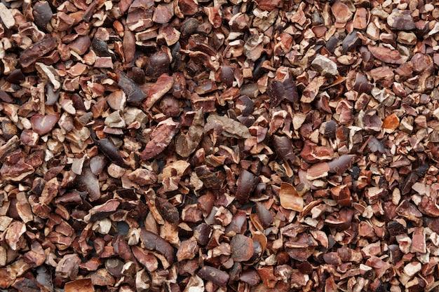 Fond de graines de cacao crues. vue de dessus.