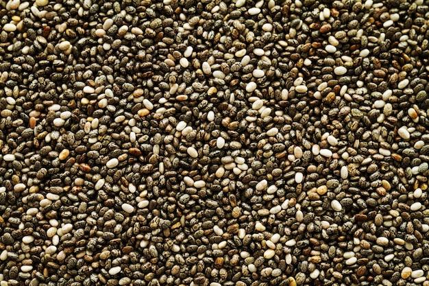 Fond de graines de chia frais savoureux. vue de dessus. superfood, concept de nourriture saine.