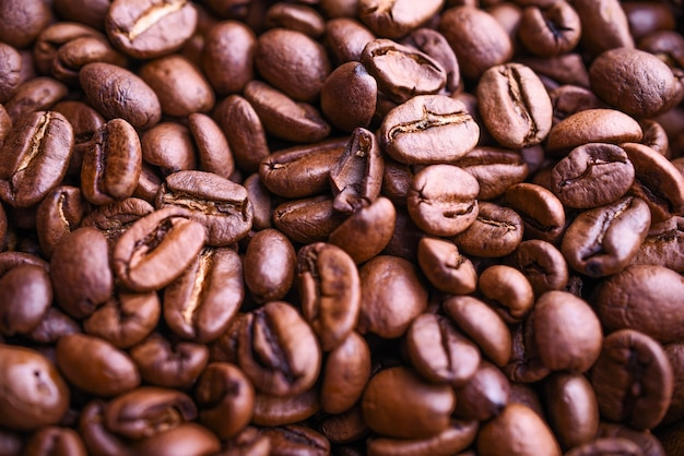 Fond de grains de café de nombreux arômes. vue de dessus