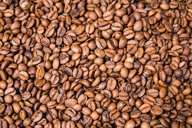 Fond de grains de café texture gros plan