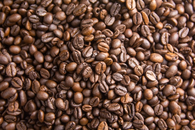 Fond de grains de café torréfiés, grains de café bruns pour peut être utilisé comme arrière-plan
