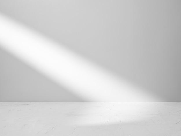 Fond gris pour la présentation du produit avec faisceau de lumière