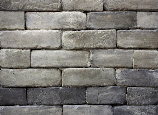 Fond gris de texture de mur de briques