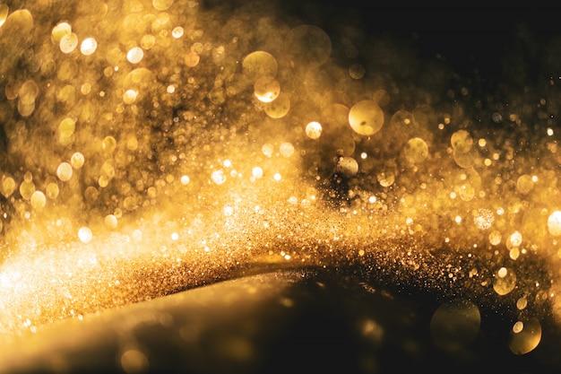 Fond de grunge de lumières scintillantes, or scintillant défocalisé abstrait fond de lumières scintillantes.