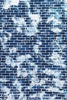 Fond grunge de mur de brique bleu classique foncé