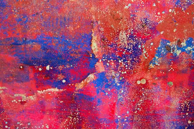 Fond grunge en rouge et rouillé coloré