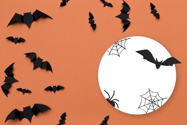 Fond d'halloween et concept de décoration chauves-souris volant