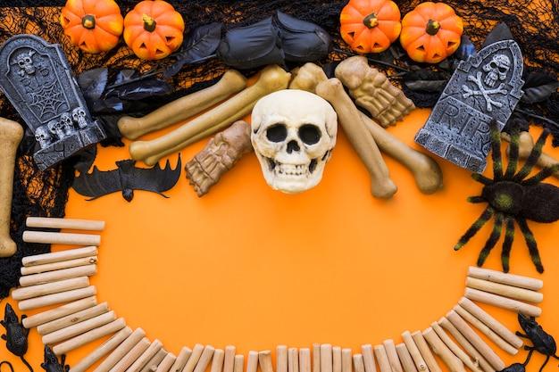 Fond d'halloween avec crâne et bâtons