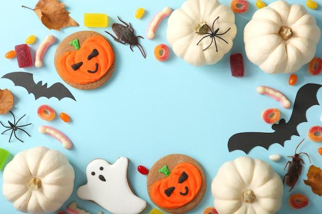 Fond d'halloween avec du pain d'épice et d'autres bonbons avec place pour le texte