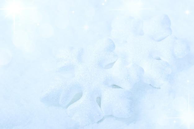 Fond d'hiver avec des flocons de neige
