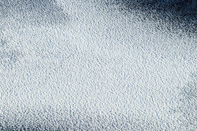 Fond d'hiver, glace de neige couverte, texture de neige