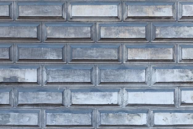 Fond horizontal de mur de brique gris industriel