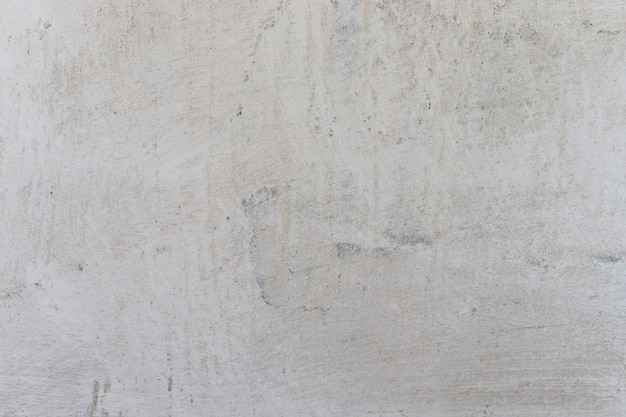 Fond horizontal de mur de chaux de plâtre blanc avec des torchis et des fractures. mur de béton avec couche de chaux, texture d'arrière-plan, mur blanchi à la chaux.