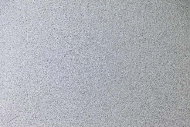 Fond industriel de mur de ciment, couleur blanc clair dans un style vintage pour la conception graphique, la construction de sites, l'affiche ou le papier peint rétro. espace de copie