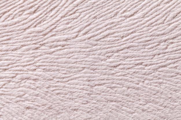 Fond ivoire en matière textile douce, tissu à texture naturelle,