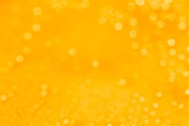 Fond jaune abstrait avec bokeh