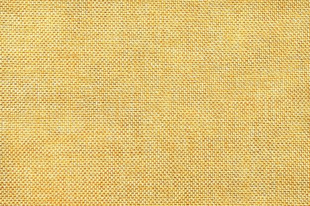 Fond jaune clair de tissu d'ensachage tissé dense