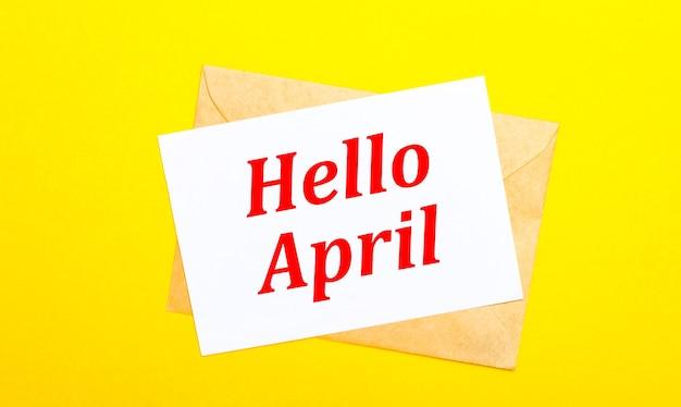Sur fond jaune, une enveloppe et une carte avec le texte bonjour avril