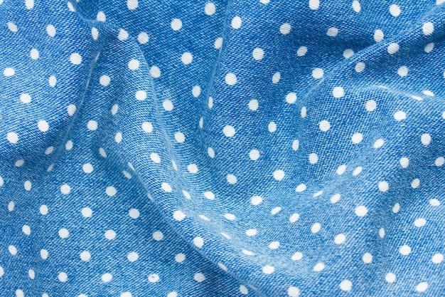Fond de jeans bleu avec texture motif à pois