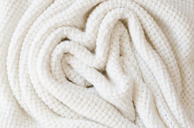 Fond de laine tricoté beige. texture de tissu en tricot.