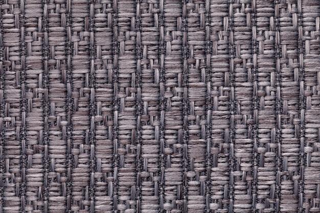 Fond en laine tricoté gris avec un motif de tissu doux et moelleux. texture du textile agrandi.