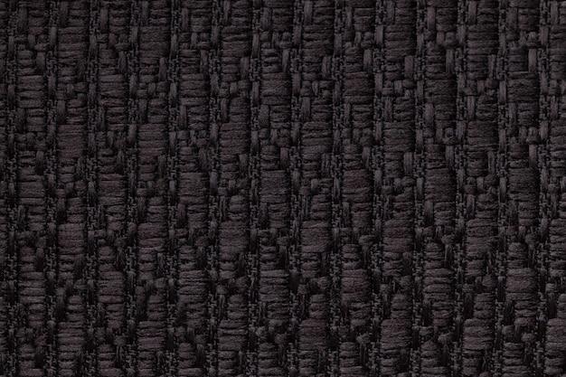 Fond en laine tricoté noir avec un motif de tissu doux et moelleux.