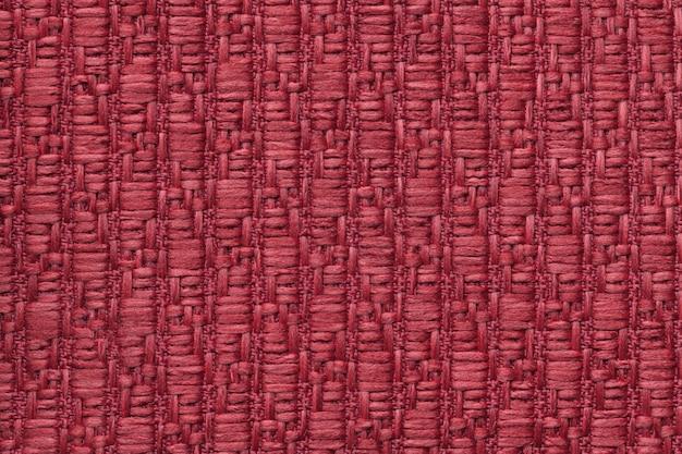 Fond en laine tricoté rouge avec un motif de tissu doux et moelleux. t