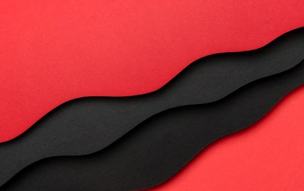 Fond de lignes obliques rouges et noires ondulées