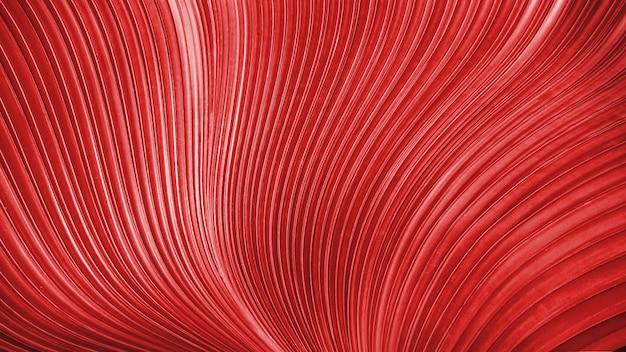 Fond de lignes de torsion lisse rouge délicat. texture de luxe abstraite pour décoratif.