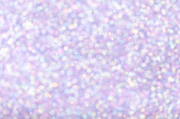 Fond lilas brillant flou avec des lumières scintillantes.