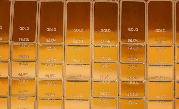 Fond de lingot. lingots d'or en rangées
