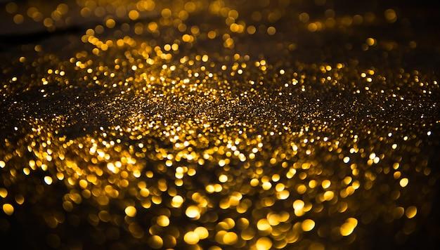 Fond de lumières vintage de paillettes défocalisé
