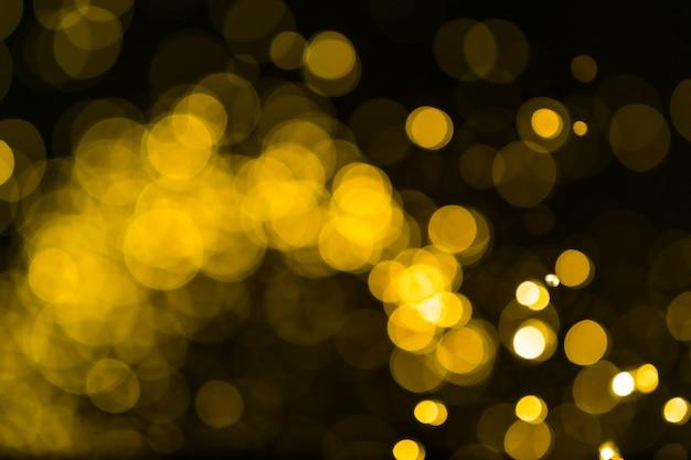 Fond de lumières vintage de paillettes. or foncé et noir. défocalisé