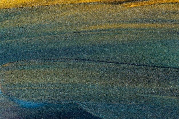 Fond de luxe magique de paillettes festives. fond noir avec des paillettes vertes dorées. espace de copie