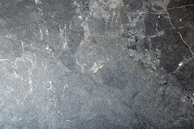 Fond de marbre noir.
