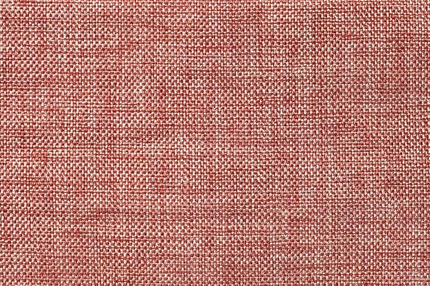 Fond marron clair de tissu d'ensachage tissé dense, gros plan. structure de la macro textile.